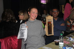 One lucky raffle ticket winner shows her two prizes