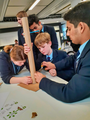 Climate conference, students building a model wind turbine